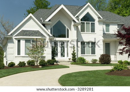 Architectural House Designs on Beautiful White Brick Home Featuring A Modern Architectural Design