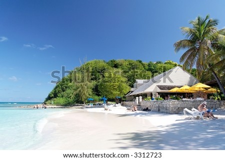 Beautiful white caribbean beach with restaurant