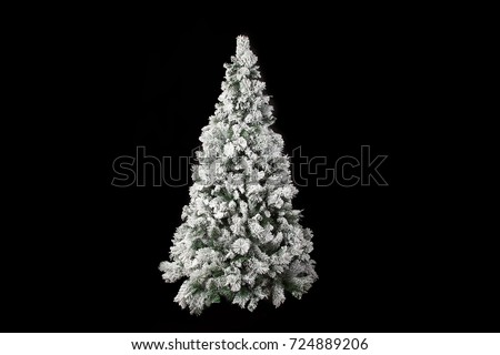 Stock Photo Beautiful white christmas tree isolated on a black background