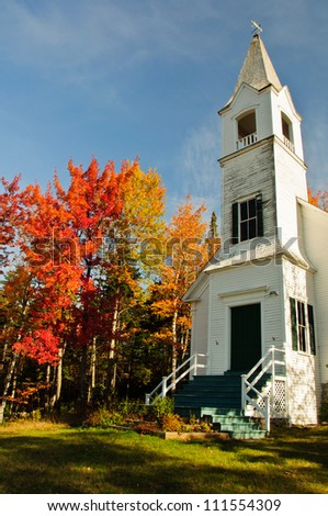 Beautiful white church and New England Fall colors.