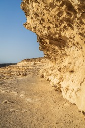 Beautiful white cliffs of limestone carved by wind and winter storms in Ajuy village on the Atlantic coast. Fuerteventura. Canary Islands. Spain.