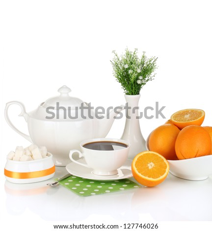 Beautiful white dinner service with oranges isolated on white