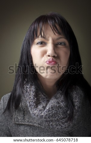 Beautiful white female with funny face #645078718