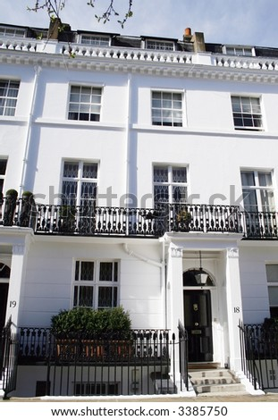 Beautiful white Georgian terraced house in Kensington, London