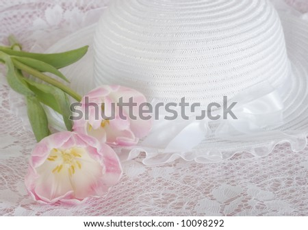 beautiful white hat with tulips on lace