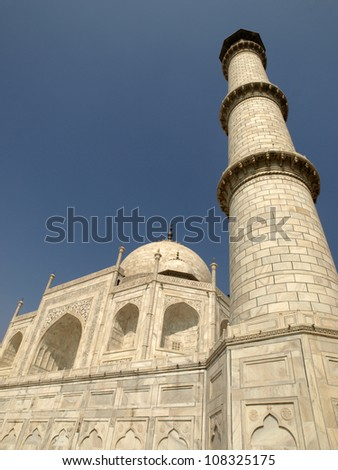 Beautiful white marble of Taj Mahal and minaret