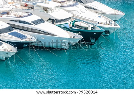 Beautiful white modern yachts at sea port in Nice, France, Europe. stock photo