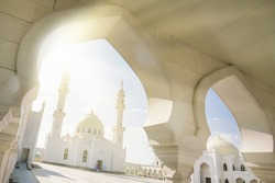 Beautiful white mosque. View from the arch