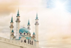 Beautiful white mosque with blue roof against the sky with clouds, sunny. Toned