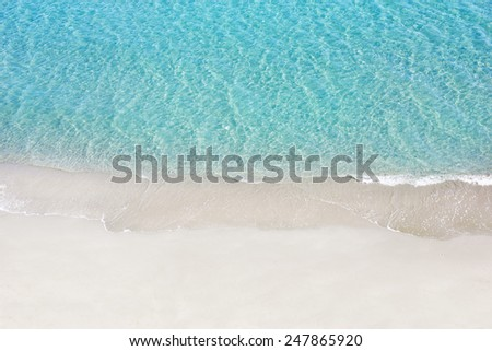 Beautiful white sand beach and tropical turquoise blue sea. View from above