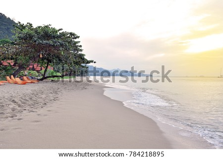 Beautiful white sand Beach at Kho Chang, Trat, Thailand 2017.  tropical beach on the island paradise in the middle of the sea. in The Nice evening With sun rise. Nice Natural and best Place to visit.