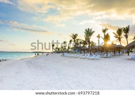 Shutterstock Beautiful white sand beach in Akumal, Mexico - paradise bay Beach in Quintana Roo - caribbean coast - sunset at Riviera Maya