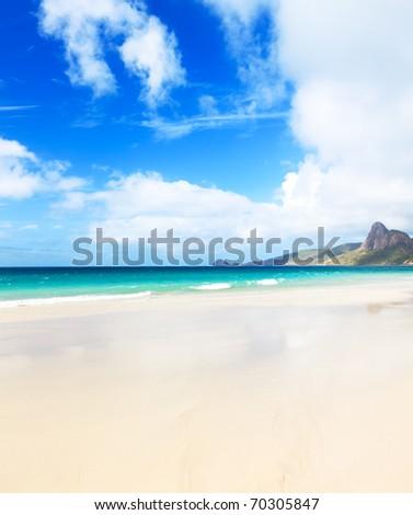 Beautiful white sand beach. Island on background