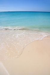 Beautiful white sand beach with turquoise sea & blue sky, Aruba, Caribbean.