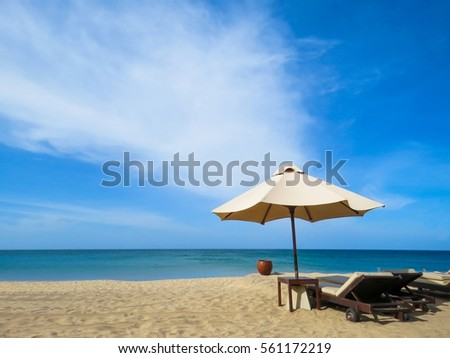 Beautiful White sand Sandy Beach with Sunbed Sun Umbrella wooden water container for washing sand off of feet   #561172219