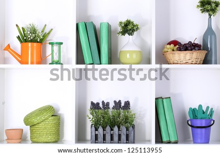 Beautiful white shelves with different gardening related objects