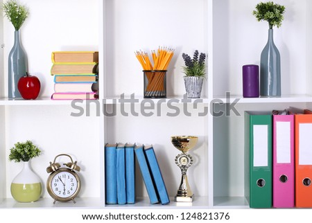 Beautiful white shelves with different home related objects