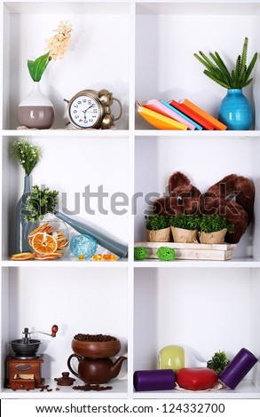 Beautiful white shelves with scattered different home related objects