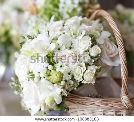 Beautiful white wedding bouquets in basket