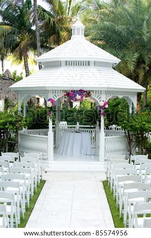 Silk Flower Arrangements on White Wedding Gazebo With Flower Arrangements Decorating   Stock Photo