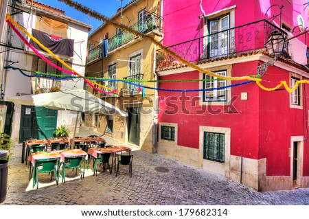 Beautiful wide angle image of the tight streets with lots of colors in Lisbon, Portugal. HDR