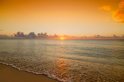 Beautiful wide angle shot of a sunset or sunrise over caribbean sea. Low perspective view.