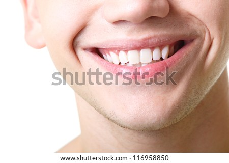 Beautiful wide smile of young man with great healthy white teeth. Isolated over white background