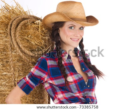 Beautiful Wild West Girl in Cowboy Hat with Rope and Straw-bale