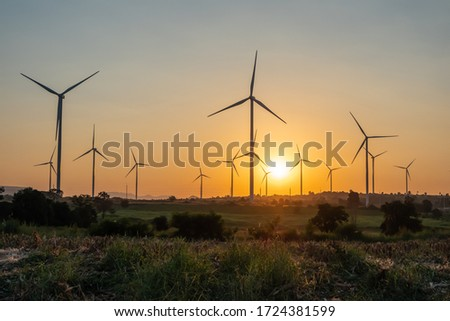 Beautiful wind turbine on the field in sunset time background Foto stock ©