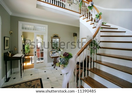 beautiful winding stairway and entry in bed and breakfast