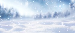 Beautiful winter background of snow and blurred forest in background, Gently falling snow flakes against blue sky, free space for your decoration. for your decorations. Wide panorama format.