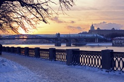 Beautiful winter cityscape, Moscow, Russia street at sunset, view of the river and bridge