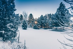 Beautiful winter countryside scene with snow and mountains.
