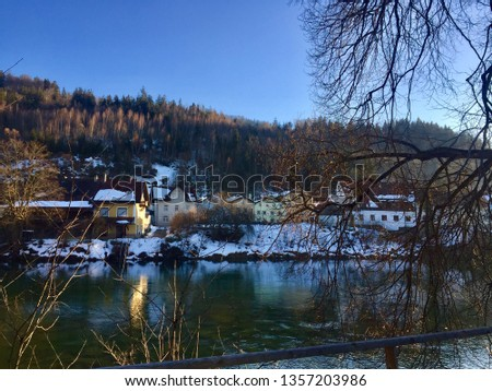 Beautiful winter day in Füssen (Fuessen). Walking along River Lech. Winter wonderland, snow, blue sky, sunshine, sunny weather (Bavaria, Ostallgäu, Allgäu, Allgau, Alps, Germany) #1357203986
