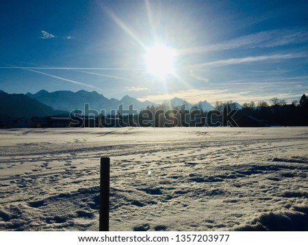 Beautiful winter day in Füssen (Fuessen). Winter wonderland, snow, blue sky, sunshine, sunny weather, hiking, cross-country skiing  (Bavaria, Ostallgäu, Allgäu, Allgau, Alps, Germany) #1357203977