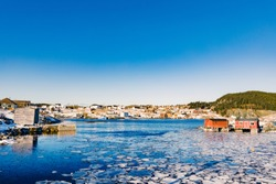 Beautiful winter day in outport village of Tizzards Harbour on New World Island, Newfoundland, NL, Canada