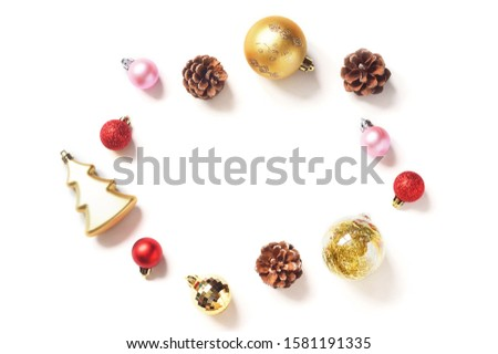 Beautiful winter frame. Christmas and New Year decoration. Red, pink, gold balls, pine cones on a white background. Xmas mockup, free space for text. Minimalist festive design #1581191335