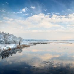 Beautiful winter lake landscape in Latvia