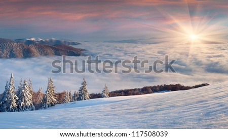 Beautiful winter landscape in the  mountains. Sunrise - stock photo