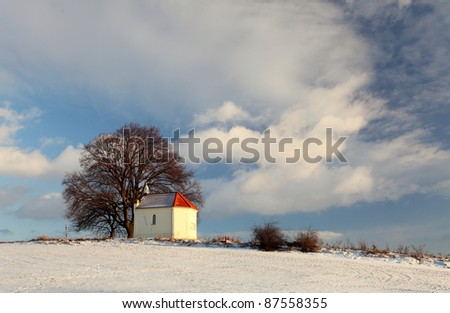 Beautiful winter landscape  with chapel