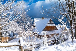 beautiful winter landscape with fresh snow with wooden hut in Zakopane Poland