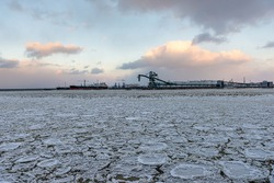 beautiful winter landscape with ship in cargo port fuel terminal at sunset time., Ventspils terminal, Latvia