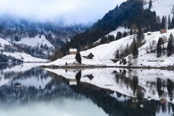 Beautiful winter landscapes along the shores of the Wagital lake in the idyllic pre-alps region of the Schwyz canton, Central Switzerland