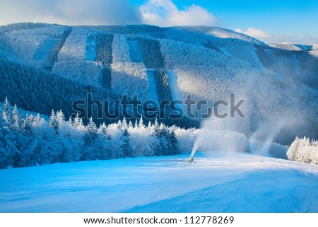 Beautiful winter mountain landscape. Downhill course with snow gun