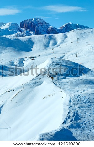 Beautiful winter mountain landscape with ski lift on slope (Sella Pass , Italy).