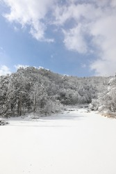 Beautiful winter mountain snow-covered landscape. Magnificent and silent sunny day. Odaesan national park, Gangwon-do, Korea.