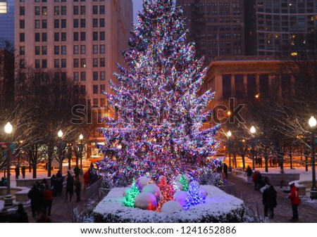 Beautiful winter night in Chicago.Chicago downtown cityscape with decorated Christmas tree glowing in the dark.Twilight winter view.Illinois,Midwest USA.Urban architecture and big city life background