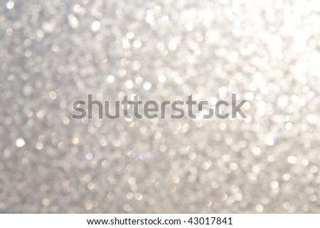 Beautiful winter picture of sparkling snow at the frozen window - stock photo