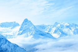 beautiful winter snow covered peaks of Caucasus mountain, Dombaj over clouds, Russia, close up