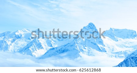 beautiful winter snow covered peaks of Caucasus mountain, Dombaj over clouds, Russia, panorama #625612868